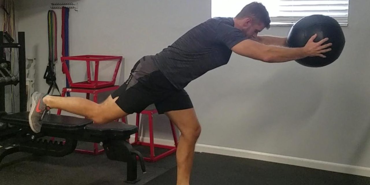 """<span class=""""entry-title-primary"""">Single Leg Med Ball Knee Drive Reach – Balance/Upper Body Control</span> <span class=""""entry-subtitle"""">Move It Monday</span>"""